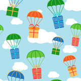 Cartoon colorful parachutes with gift boxes Stock Photos