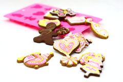 Cartoon cookies. And mold on the white background Royalty Free Stock Photo