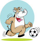 Cartoon cow playing soccer. Stock Photography