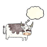 Cartoon cow with thought bubble Stock Image