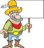 Cartoon cowboy holding a sign. Royalty Free Stock Photos