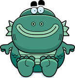 Cartoon Creature Sitting. A cartoon illustration of a fish creature sitting Royalty Free Stock Image