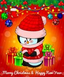 Cartoon cristmas penguin with gift boxes on red background. Vector illustration Stock Image