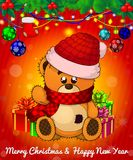 Cartoon cristmas teddy bear with gift boxes on red background. Royalty Free Stock Images