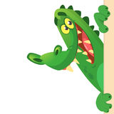Cartoon crocodile or alligator holding and looking over a blank sign board. Vector illustration. Cartoon crocodile or alligator holding and looking over a blank Stock Image