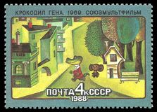 Cartoon Crocodile Gena. USSR - stamp 1988: Color edition dedicated to Soviet cartoons, shows Episode from the cartoon Crocodile Gena royalty free stock images