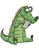 Cartoon crocodile using a computer tablet. Isolated on white Royalty Free Stock Photo
