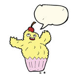Cartoon cupcake monster with speech bubble Royalty Free Stock Photo
