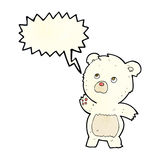 Cartoon curious polar bear with speech bubble Royalty Free Stock Photo