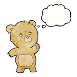 Cartoon curious teddy bear with thought bubble Stock Photo