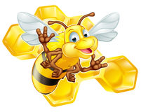 Cartoon cute bee with honeycomb Stock Photo