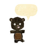 Cartoon cute black bear cub with speech bubble Royalty Free Stock Images