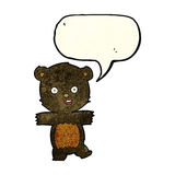 Cartoon cute black bear cub with speech bubble Royalty Free Stock Photo