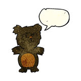 Cartoon cute black bear cub with speech bubble Royalty Free Stock Photos