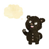Cartoon cute black bear cub with thought bubble Royalty Free Stock Image