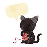 cartoon cute black cat playing with ball of yarn with speech bub Stock Photography