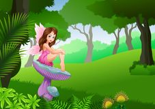 Cartoon cute fairy sitting on mushroom in the tropical forest background Royalty Free Stock Image