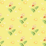 Cartoon cute flowers seamless pattern on yellow Royalty Free Stock Images