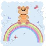 Cartoon a cute happy bear sitting on the rainbow. Holds a barrel of honey stock illustration