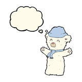 Cartoon cute polar bear in hat and scarf with thought bubble Stock Photo