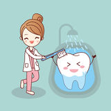 Cartoon dentist is brush tooth stock illustration