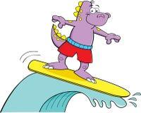 Cartoon dinosaur surfing Stock Photos