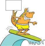 Cartoon dinosaur surfing and holding a sign. Royalty Free Stock Photos