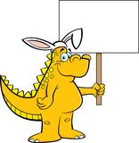 Cartoon dinosaur wearing rabbit ears and holding a sign. Stock Photos