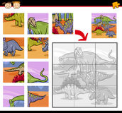 Cartoon dinosaurs jigsaw puzzle game Stock Images