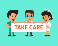 Cartoon doctor and nurses holding take care sign Royalty Free Stock Photo