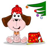 Cartoon dog and Christmas gift Royalty Free Stock Photos