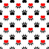 Cartoon dog paw prints - seamless pattern. Red heart on a white Royalty Free Stock Image