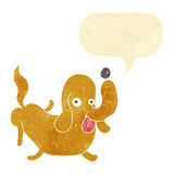 Cartoon dog sticking out tongue with speech bubble Royalty Free Stock Photos
