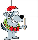 Cartoon dog wearing a wreath and Santa hat holding a sign. Royalty Free Stock Photo