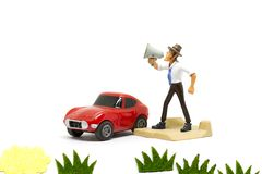 Cartoon doll standing shouting using a megaphone. Stock Images