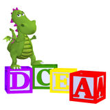 Cartoon dragon with abc blocks. Isolated on the white background Stock Images