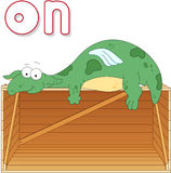 Cartoon Dragon Lies On A Box. English Grammar In Pictures Stock Photography