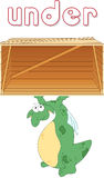 Cartoon dragon stands under a box. English grammar in pictures Stock Image