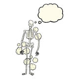 Cartoon dusty old skeleton with thought bubble Stock Image