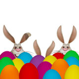 Cartoon Easter bunnies with many colorful easter eggs Royalty Free Stock Photos