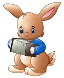 Cartoon Easter bunny carrying a basket full of eggs. Illustration of Cartoon Easter bunny carrying a basket full of eggs Royalty Free Stock Image