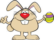 Cartoon Easter Bunny Holding an Easter Egg Royalty Free Stock Photography