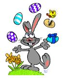 Cartoon Easter bunny juggling eggs Stock Images