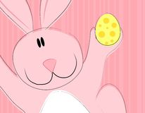 Cartoon Easter Bunny Rabbit Holding Egg. A clip art illustration featuring an Easter Bunny Rabbit closeup holding an egg in pink colors Royalty Free Stock Photo