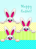 Cartoon easter bunnies in basket looking up Royalty Free Stock Image