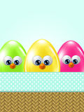 Cartoon easter eggs in basket. With place for text Royalty Free Stock Photos