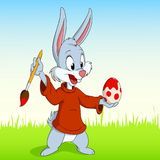 Cartoon easter rabbit paint the egg Royalty Free Stock Photo