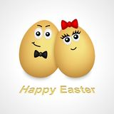Cartoon egg boy and girl. Cartoon eggs with face and black and red ribbon Stock Image