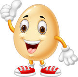 Cartoon egg giving thumb up Stock Images