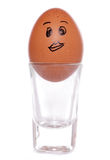 Cartoon egg in shot glass egg cup Stock Photos